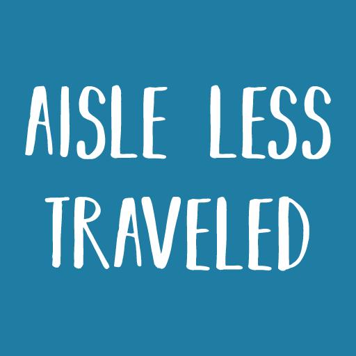 "Aisle Less Traveled logo. White text on a medium blue background reads ""Aisle Less Traveled"""