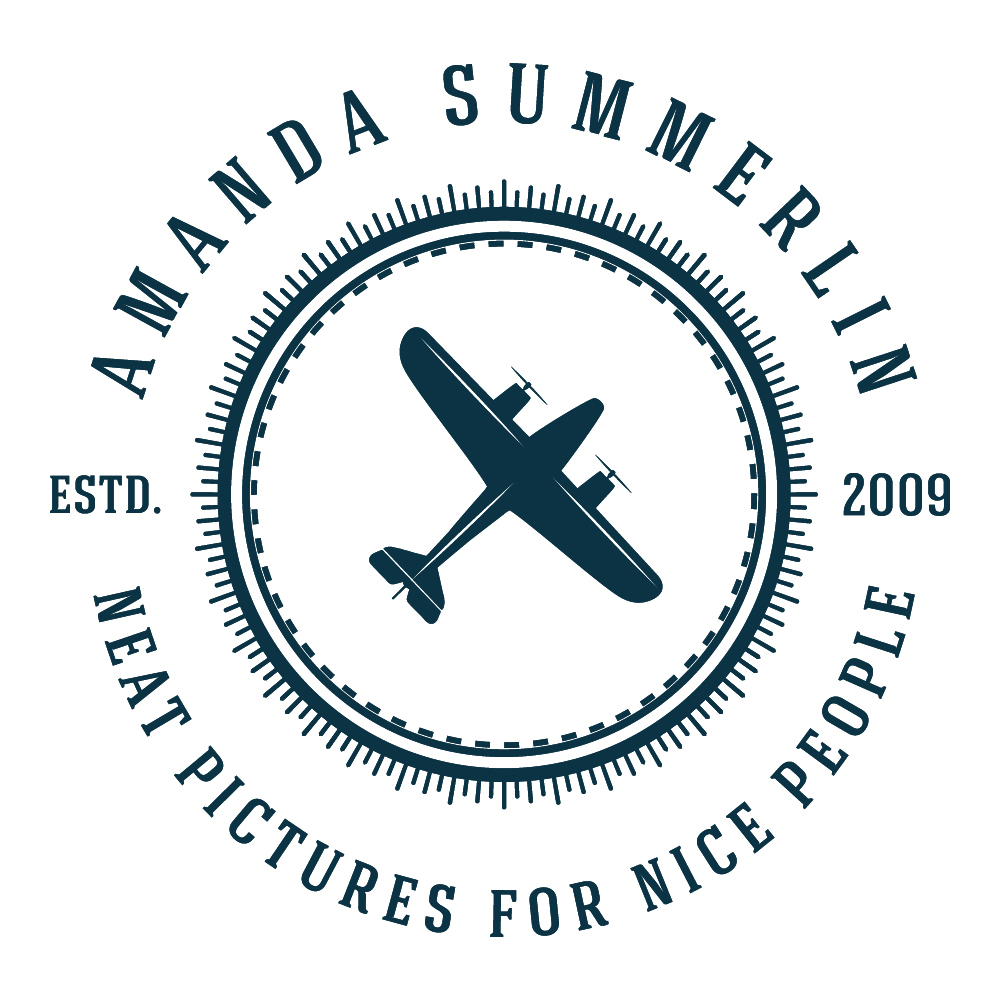"Amanda Summerlin Photography logo. Dark blue text on white background with image of an airplane in the center of a circle. Text around the circle reads ""Amanda Summerlin. Neat Pictures for Nice People. Estd. 2009"""